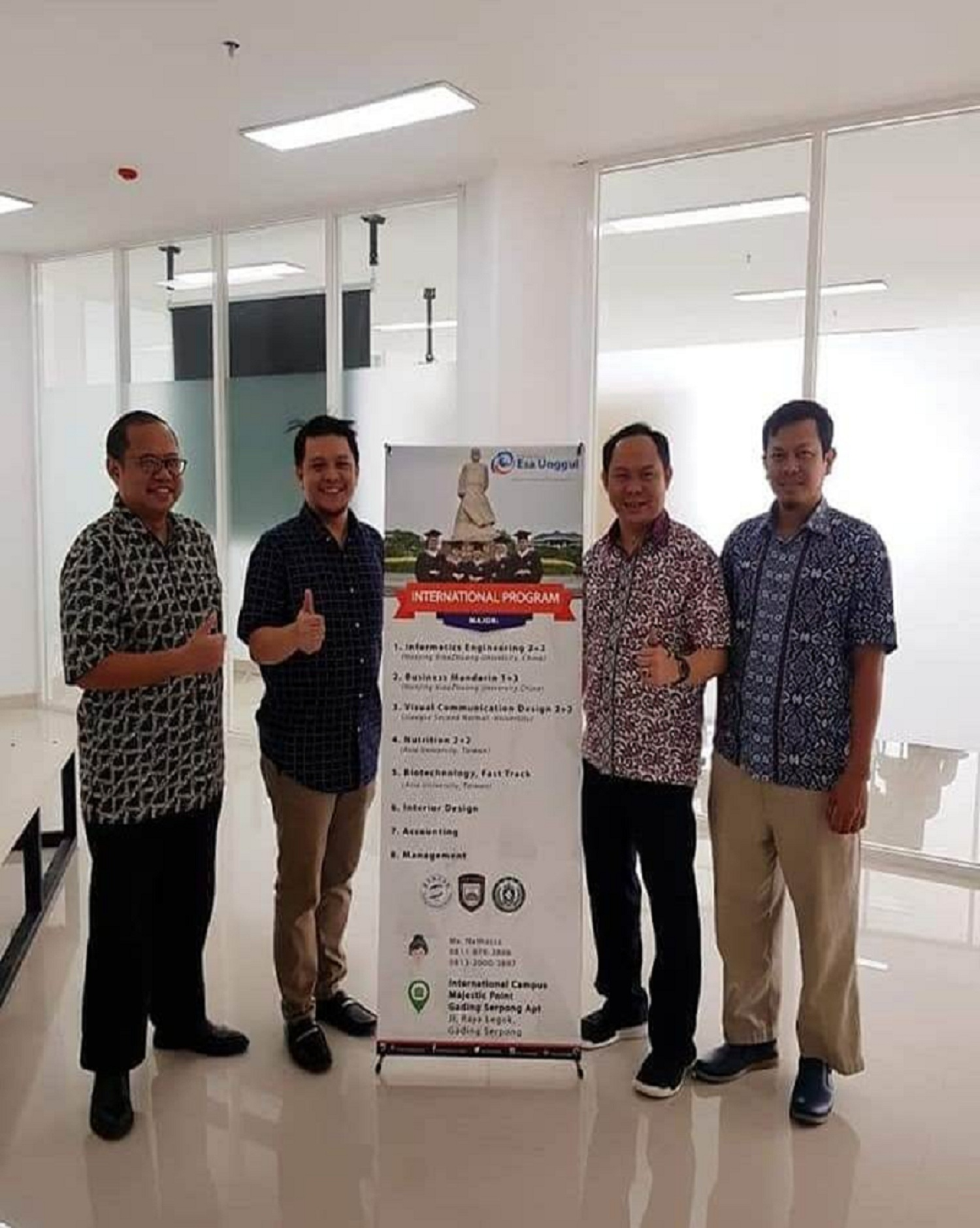 Dr. Fransiskus Adikara, Director of Esa Unggul University Gading Serpong International Campus (Second from the right) taking a photo together.